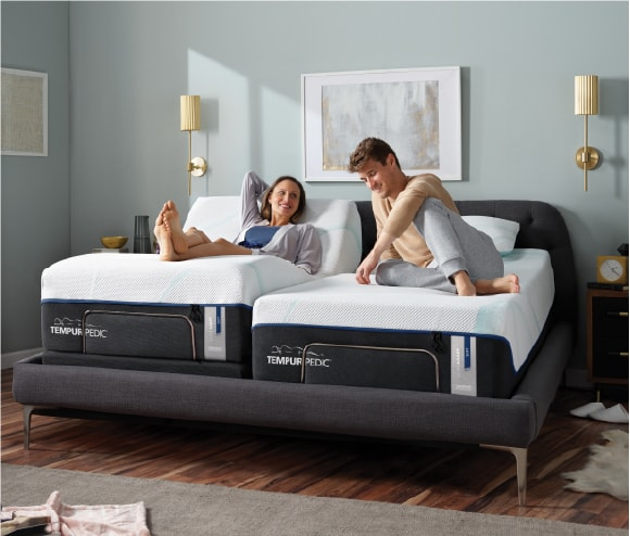 couple laying on tempurpedic mattresses